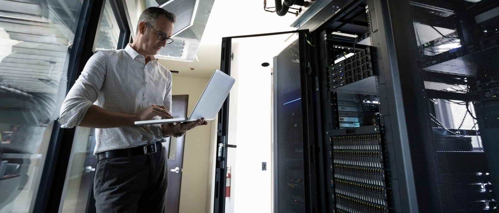man standing in server room