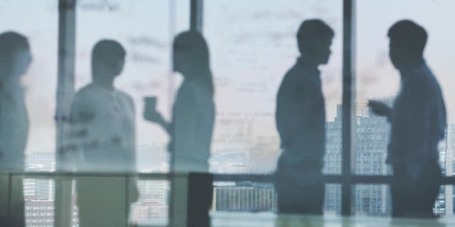blurry silhouettes in office