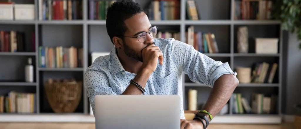 Man thinking about the windows 365 and azure virtual desktop differences